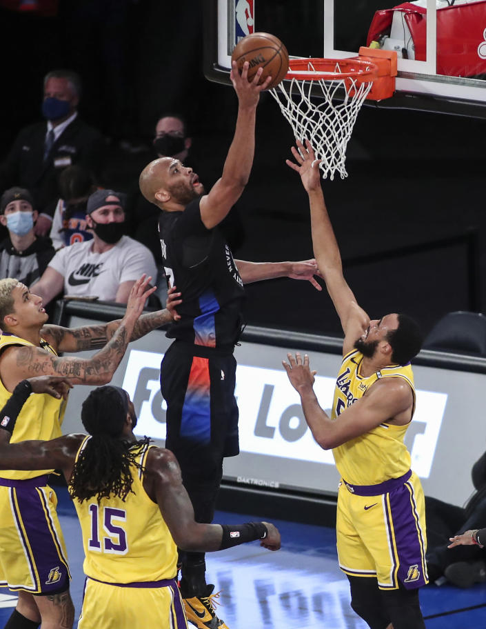 New York Knicks center Taj Gibson (67) puts back an offensive rebound against the Los Angeles Lakers in the second quarter of an NBA basketball game at Madison Square Garden in New York, Monday, April 12, 2021. (Wendell Cruz/Pool Photo via AP)