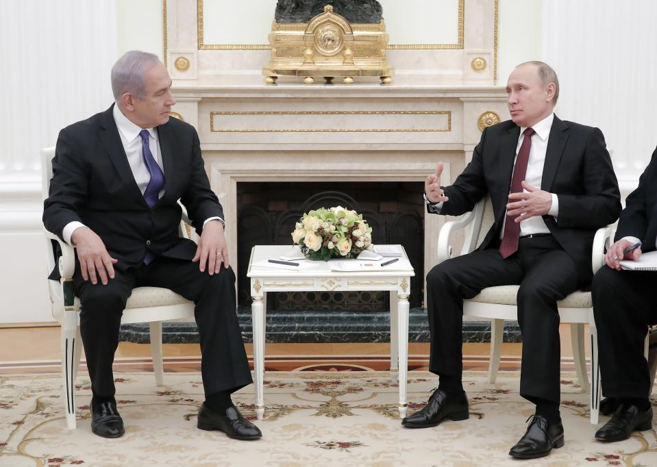 Russian President Vladimir Putin, right, gestures while speaking to Israeli Prime Minister Benjamin Netanyahu during their meeting in the Kremlin in Moscow, Russia, Wednesday, Feb. 27, 2019. The talks are expected to focus on the situation in Syria. (Maxim Shemetov/Pool Photo via AP)