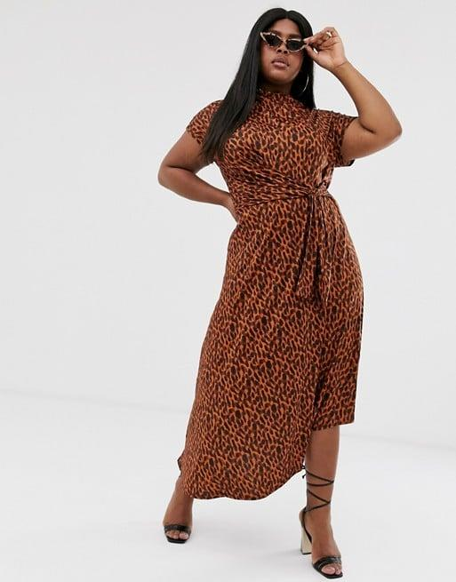"<p>We love the print on this <a href=""https://www.popsugar.com/buy/ASOS-DESIGN-Curve-Printed-Midi-Dress-483397?p_name=ASOS%20DESIGN%20Curve%20Printed%20Midi%20Dress&retailer=us.asos.com&pid=483397&price=60&evar1=fab%3Aus&evar9=45320445&evar98=https%3A%2F%2Fwww.popsugar.com%2Ffashion%2Fphoto-gallery%2F45320445%2Fimage%2F46582386%2FASOS-DESIGN-Curve-Printed-Midi-Dress&list1=shopping%2Cfall%20fashion%2Cdresses%2Cfall&prop13=mobile&pdata=1"" rel=""nofollow"" data-shoppable-link=""1"" target=""_blank"" class=""ga-track"" data-ga-category=""Related"" data-ga-label=""https://us.asos.com/asos-curve/asos-design-voted-by-you-curve-cowl-neck-tie-waist-midi-dress-in-tortoiseshell-print/prd/13054350?clr=brown-tortoiseshell&amp;colourWayId=16473133&amp;SearchQuery=midi%20dress"" data-ga-action=""In-Line Links"">ASOS DESIGN Curve Printed Midi Dress</a> ($60).</p>"