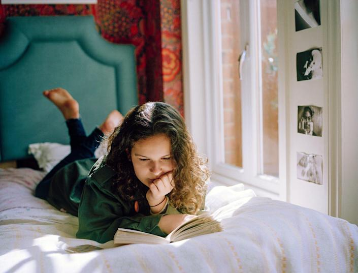 An image of a teen reading.
