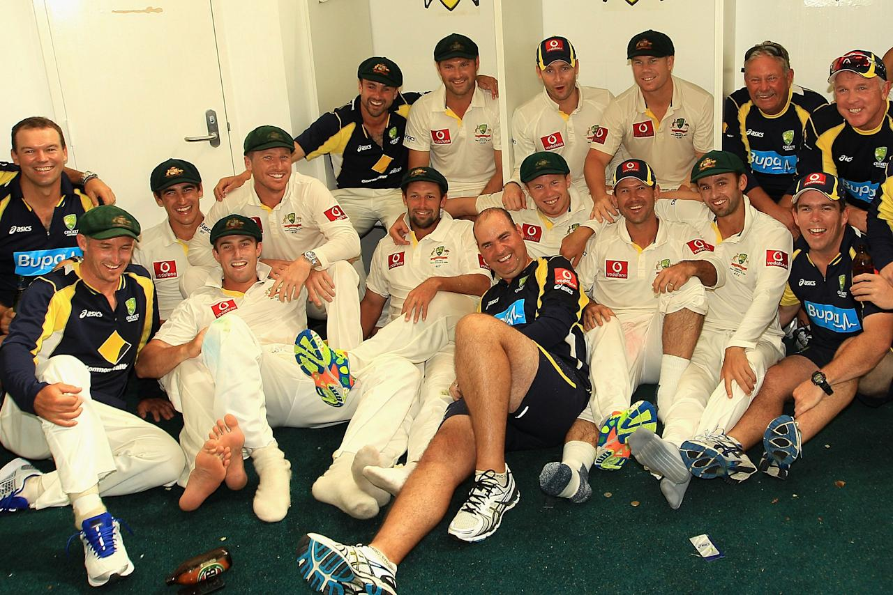 PERTH, AUSTRALIA - JANUARY 15:  The Australian team celebrate their win in the dressing rooms after day three of the Third Test match between Australia and India at WACA on January 15, 2012 in Perth, Australia.  (Photo by Hamish Blair/Getty Images)