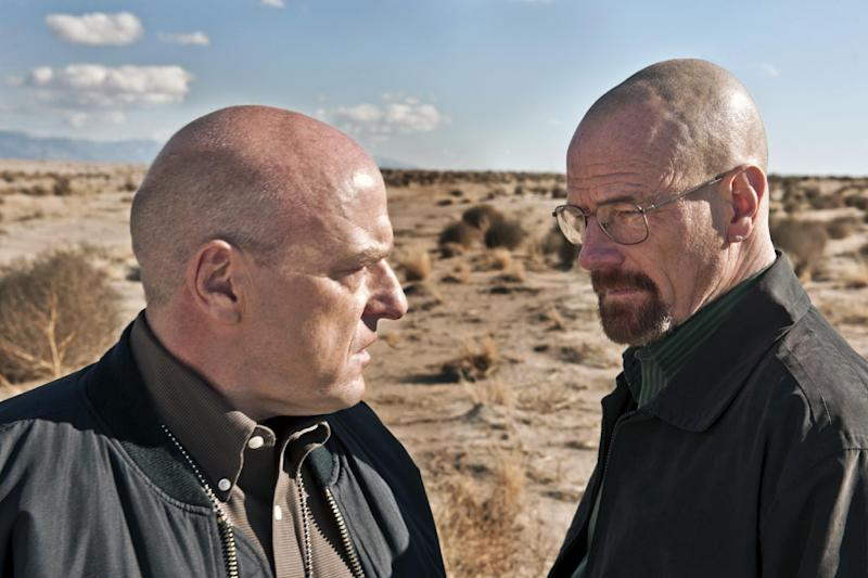 "This publicity image released by AMC shows Dean Norris as Hank Schrader, left, and Bryan Cranston as Walter White in ""Breaking Bad."" The series is returning for its eight final episodes starting Sunday at 9 p.m. EDT. The long-awaited showdown places Hank in direct conflict with the villainous hero, Walter White. (AP Photo/AMC, Frank Ockenfels)"
