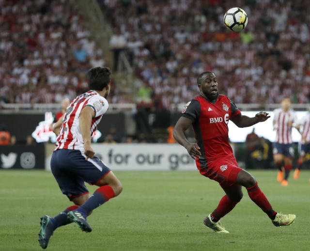 Toronto FC's Jozy Altidore, right, goes after the ball as Chivas' Oswaldo Alanis gives chase during the CONCACAF Champions League final soccer match in Guadalajara, Mexico, Wednesday, April, 25, 2018. (AP Photo/Eduardo Verdugo)