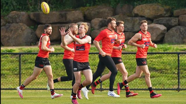 Conor McKenna (l) and the entire Essendon backline could be forced into quarantine for 14 days