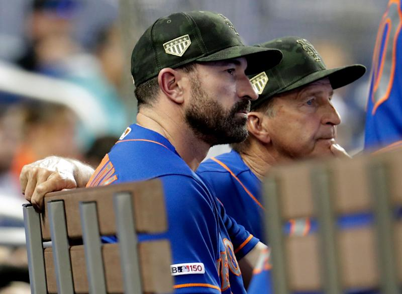New York Mets manager Mickey Callaway, left, watches in the eighth inning during a baseball game against the Miami Marlins, Sunday, May 19, 2019, in Miami. The Marlins won 3-0. (AP Photo/Lynne Sladky)