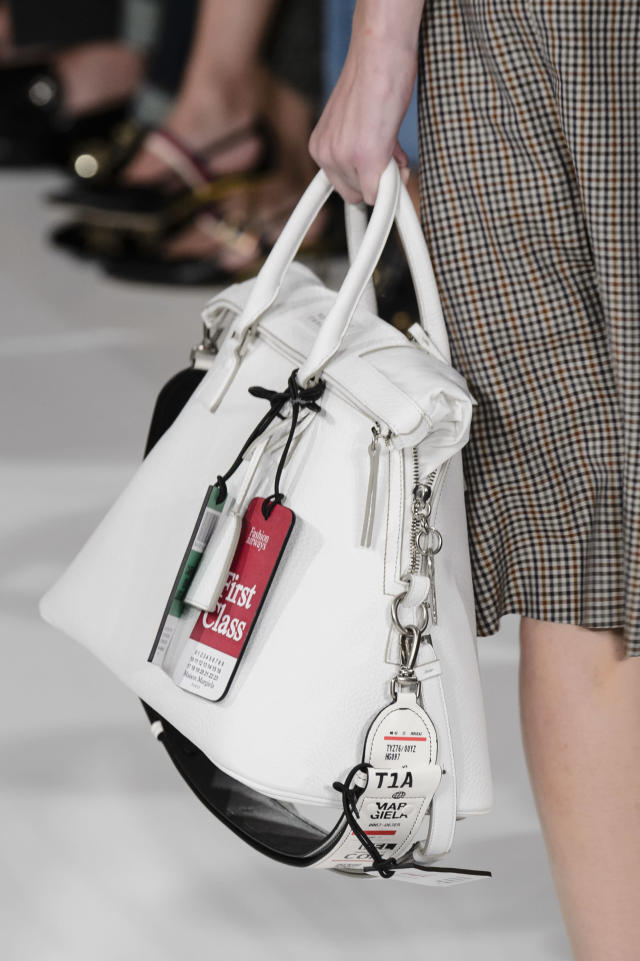 <p><i>White handbag with leather travel tags attached from the SS18 Maison Margiela collection. (Photo: ImaxTree) </i></p>