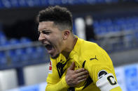 Dortmund's Jadon Sancho celebrates at the end of the German Bundesliga soccer match between FC Schalke 04 and Borussia Dortmund in Gelsenkirchen, Germany, Saturday, Feb. 20, 2021. Dortmund won 4-0. (AP Photo/Martin Meissner, Pool)