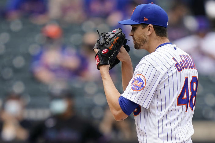 New York Mets starting pitcher Jacob deGrom gets set to throw in the first inning of a baseball game against the Miami Marlins, Saturday, April 10, 2021, in New York. (AP Photo/John Minchillo)