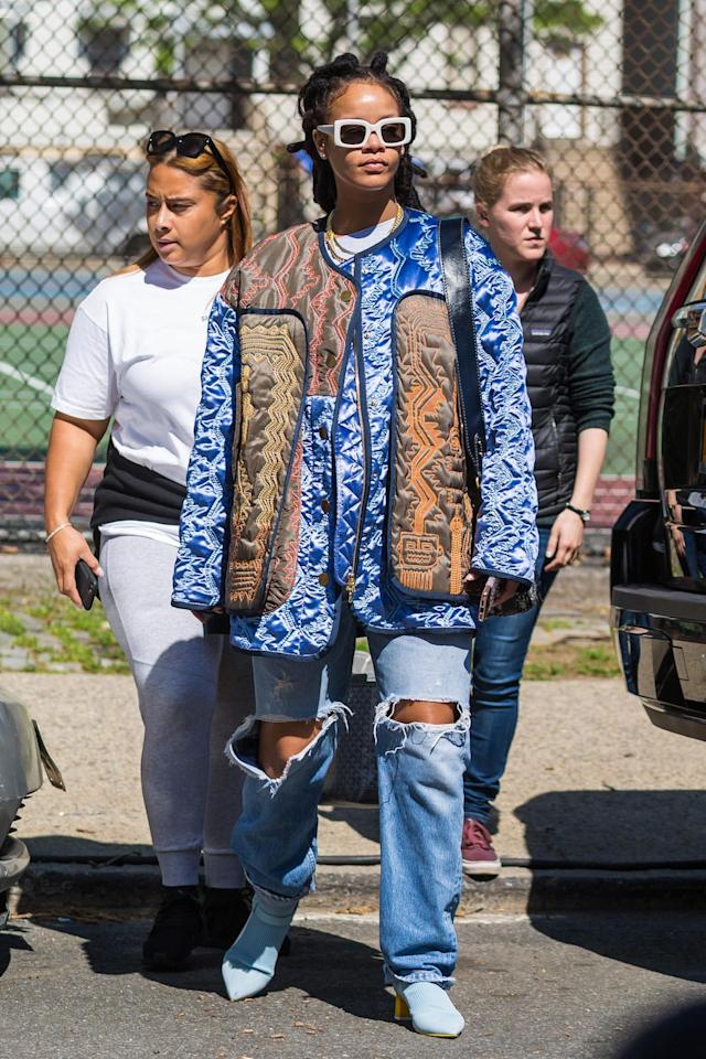 """<p>Rihanna is spotted on the set of """"Ocean's 8"""" in New York wearing her Raen sunglasses with a quilted jacket and distressed jeans. (Photo: Alessio Botticelli/GC Images) </p>"""