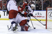 Florida Panthers center Noel Acciari (55) and Columbus Blue Jackets left wing Sonny Milano, right, fight for the puck during the second period of an NHL hockey game, Saturday, Dec. 7, 2019, in Sunrise, Fla. (AP Photo/Lynne Sladky)