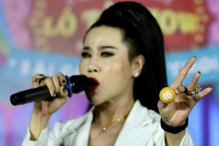La Kim Quyen has been performing with lotto troupes in Vietnam since she was a teenager (AFP Photo/Manan VATSYAYANA)