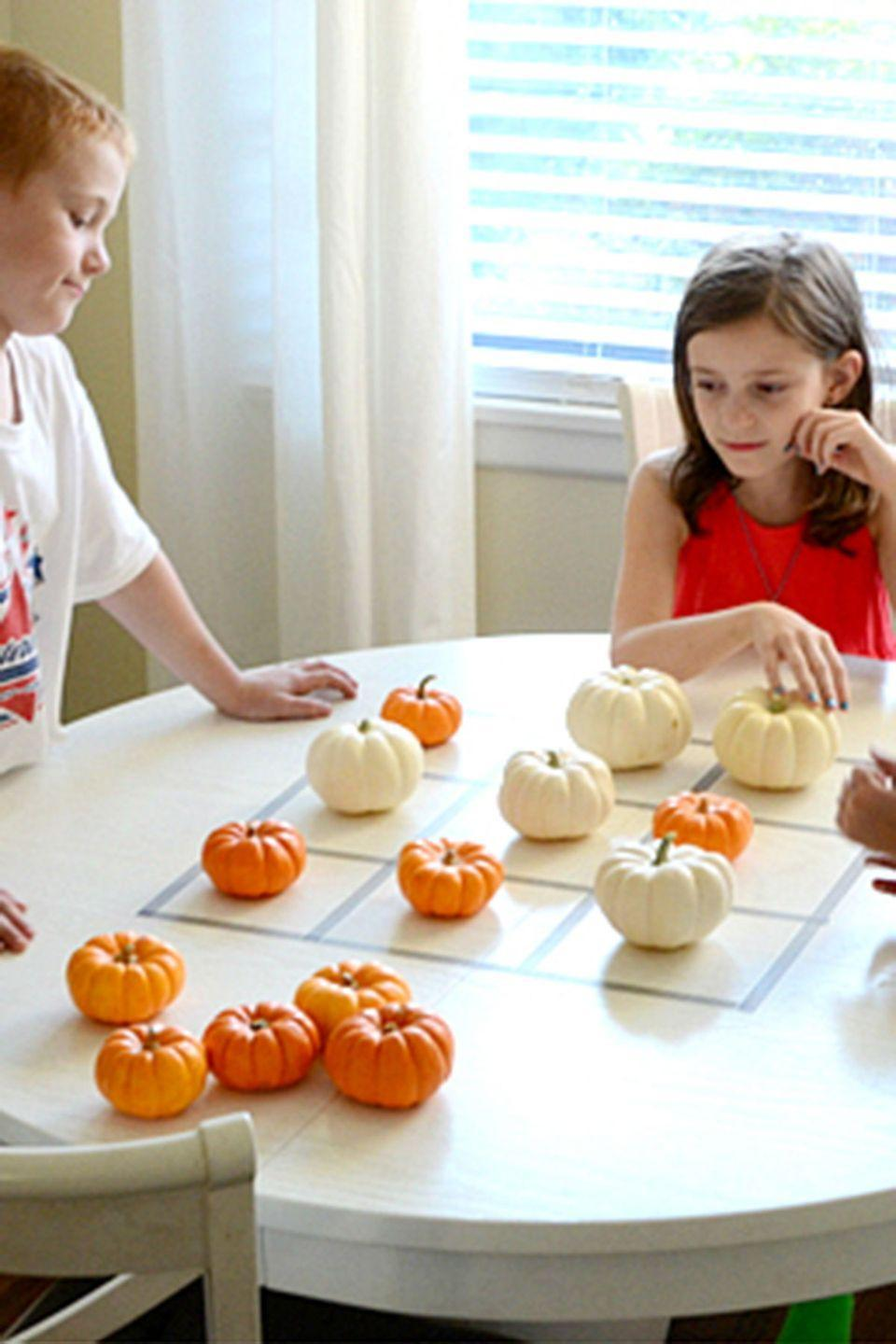 """<p>Put a fall spin on this classic game. All you'll need are mini pumpkins in two different colors.</p><p><strong>Get the tutorial at <a href=""""http://www.itsoverflowing.com/2012/11/create-a-kids-game/"""" rel=""""nofollow noopener"""" target=""""_blank"""" data-ylk=""""slk:It's Overflowing"""" class=""""link rapid-noclick-resp"""">It's Overflowing</a>.</strong> </p><p><a class=""""link rapid-noclick-resp"""" href=""""https://www.amazon.com/Sackorange-Colorful-Decorative-Christmas-Scrapbook/dp/B075VL6WW4/?tag=syn-yahoo-20&ascsubtag=%5Bartid%7C10050.g.4698%5Bsrc%7Cyahoo-us"""" rel=""""nofollow noopener"""" target=""""_blank"""" data-ylk=""""slk:SHOP WASHI TAPE"""">SHOP WASHI TAPE</a></p>"""