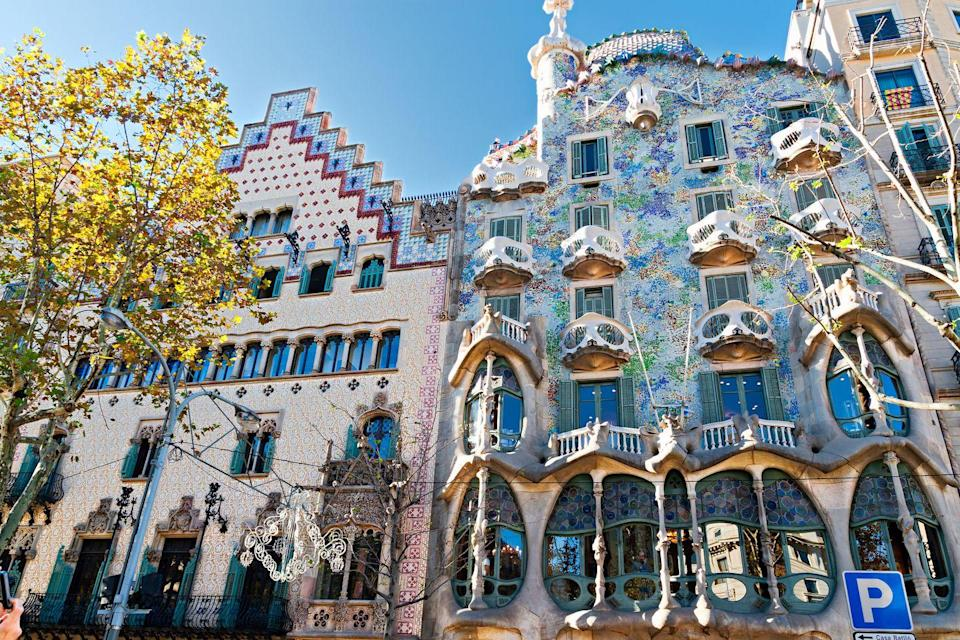 "<p>Known as one of the most prolific architects of Catalan Modernism, Antoni Gaudí was given complete creative freedom to renovate Josep Batlló's Barcelona home in 1904. The exuberant facade was inspired by marine life with recycled stone, glass, and ceramics coming together to create three distinct sections: a base level boasting a skeletal appearance, a middle section bursting with patterns and color, and a scale-like roof. One of the most unique spaces of <a href=""https://www.casabatllo.es/en/"" rel=""nofollow noopener"" target=""_blank"" data-ylk=""slk:Casa Batlló"" class=""link rapid-noclick-resp"">Casa Batlló</a>, the loft features a series of 60 catenary arches, mimicking the ribcage of an animal. <br></p>"