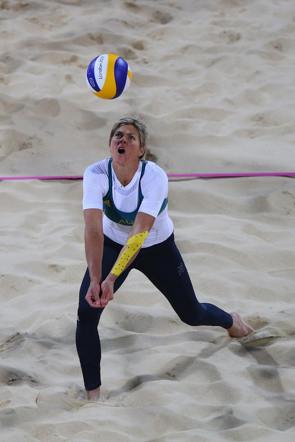LONDON, ENGLAND - JULY 28: Nat Cook of Australia dives for the ball against the United States during the Women's Beach Volleyball Preliminary Round on Day 1 of the London 2012 Olympic Games at Horse Guards Parade on July 28, 2012 in London, England. (Photo by Ryan Pierse/Getty Images)