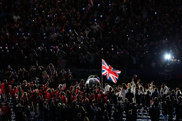 LONDON, ENGLAND - AUGUST 29: Wheelchair tennis player Peter Norfolk of Great Britain carries the flag during the Opening Ceremony of the London 2012 Paralympics at the Olympic Stadium on August 29, 2012 in London, England. (Photo by Mike Ehrmann/Getty Images)