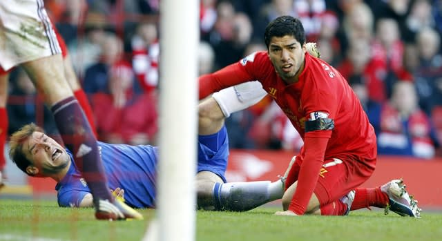Suarez (right) and Chelsea's Branislav Ivanovic (left) on the ground after Suarez bit Ivanovic on the arm (Peter Byrne/PA)