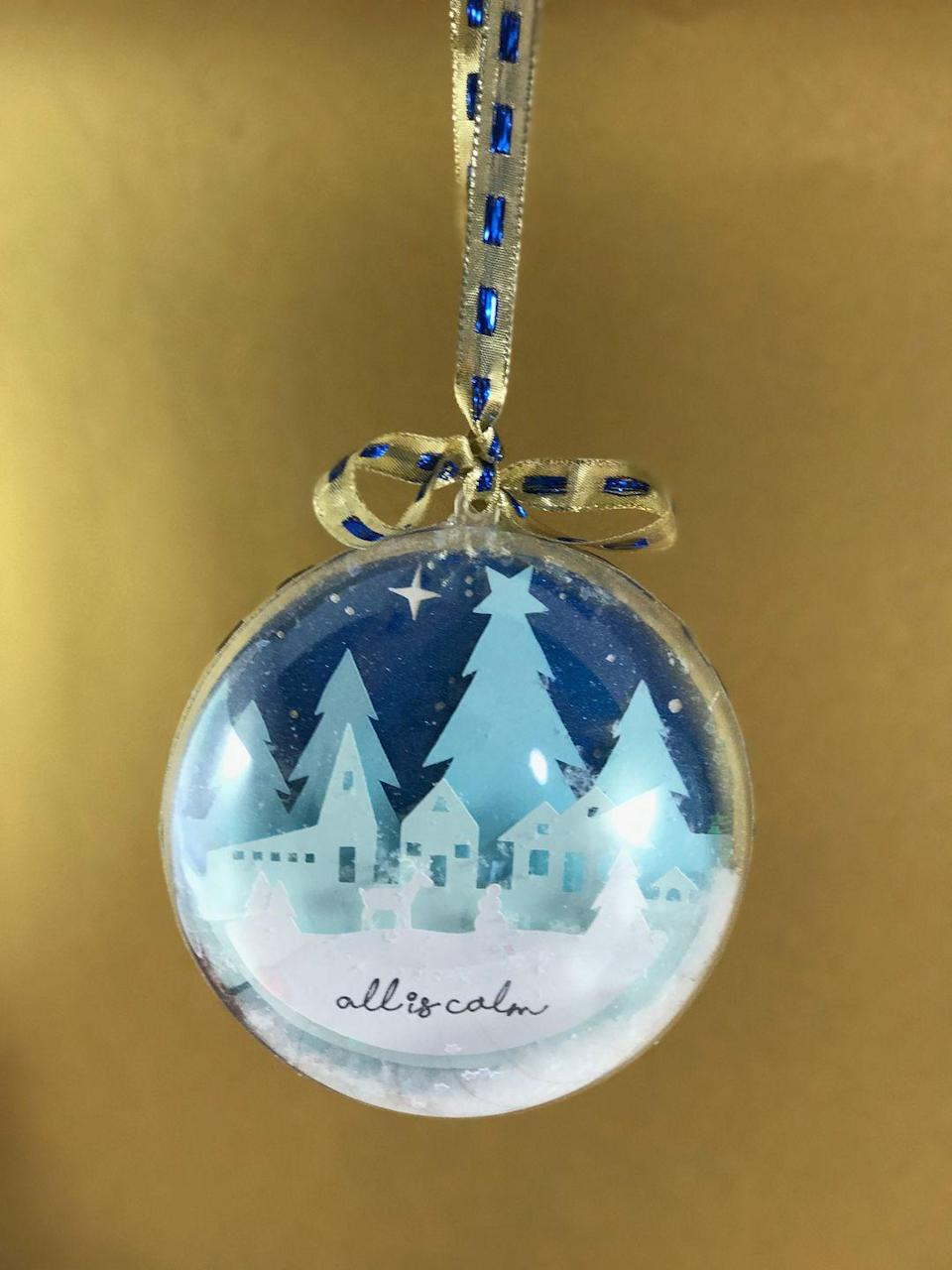 """<p>These gorgeous two-sided ornaments feature different scenes on each side with plenty of glitter factor. They make beautiful one-of-a-kind gifts.</p><p><strong>Get the tutorial at <a href=""""https://jennifermaker.com/diy-glitter-ball-ornament/"""" rel=""""nofollow noopener"""" target=""""_blank"""" data-ylk=""""slk:Jennifer Maker"""" class=""""link rapid-noclick-resp"""">Jennifer Maker</a>. </strong></p><p><a class=""""link rapid-noclick-resp"""" href=""""https://www.amazon.com/Sulyn-0-8oz-Glitter-Flakes-Crystal/dp/B009CFXH0O/?tag=syn-yahoo-20&ascsubtag=%5Bartid%7C10050.g.28831556%5Bsrc%7Cyahoo-us"""" rel=""""nofollow noopener"""" target=""""_blank"""" data-ylk=""""slk:SHOP GLITTER FLAKES"""">SHOP GLITTER FLAKES</a></p>"""