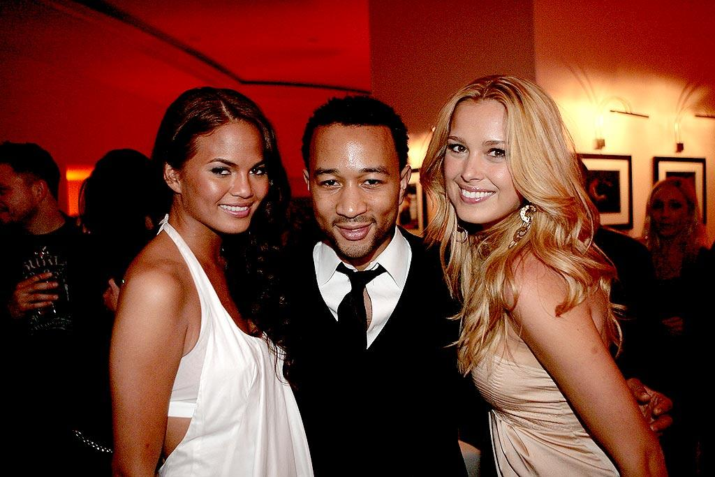 """Did someone order a supermodel sandwich? John Legend was the envy of every man while posing with girlfriend Christine Teigen (left) and Petra Nemcova (right). Charley Gallay/<a href=""""http://www.wireimage.com"""" target=""""new"""">WireImage.com</a> - February 10, 2008"""
