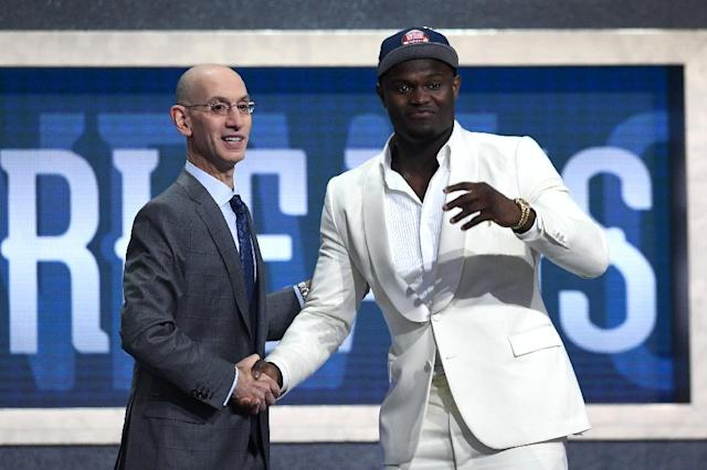 Zion Williamson poses with NBA commissioner Adam Silver after being taken first overall by the New Orleans Pelicans during the 2019 NBA Draft (AFP Photo/Sarah Stier)