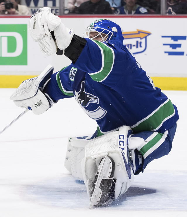 Vancouver Canucks goalie Jacob Markstrom, of Sweden, makes a glove-save against the Carolina Hurricanes during the first period of an NHL hockey game in Vancouver, British Columbia, Thursday, Dec. 12, 2019. (Darryl Dyck/The Canadian Press via AP)