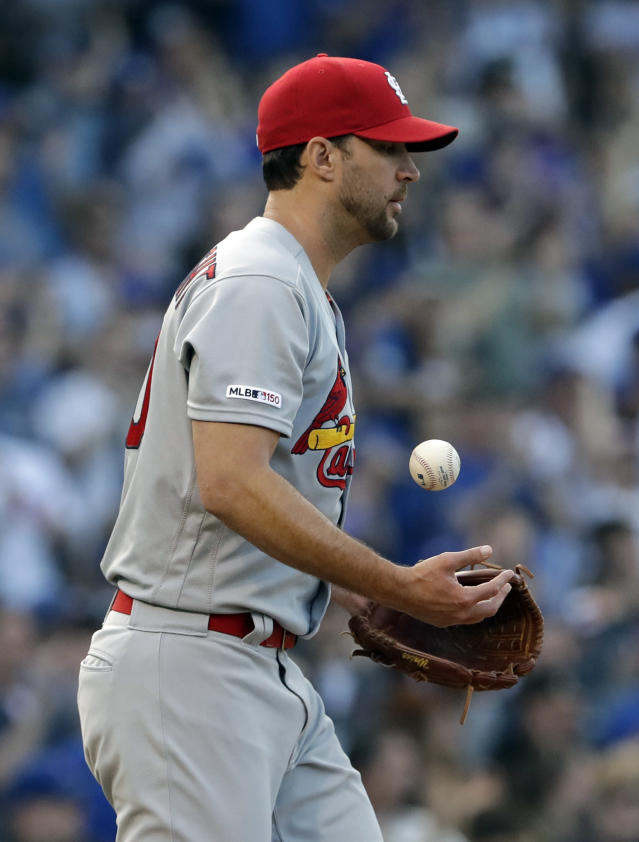 St. Louis Cardinals starting pitcher Adam Wainwright tosses the ball after Chicago Cubs' Willson Contreras hit a solo home run during the second inning of a baseball game Sunday, May 5, 2019, in Chicago. (AP Photo/Nam Y. Huh)