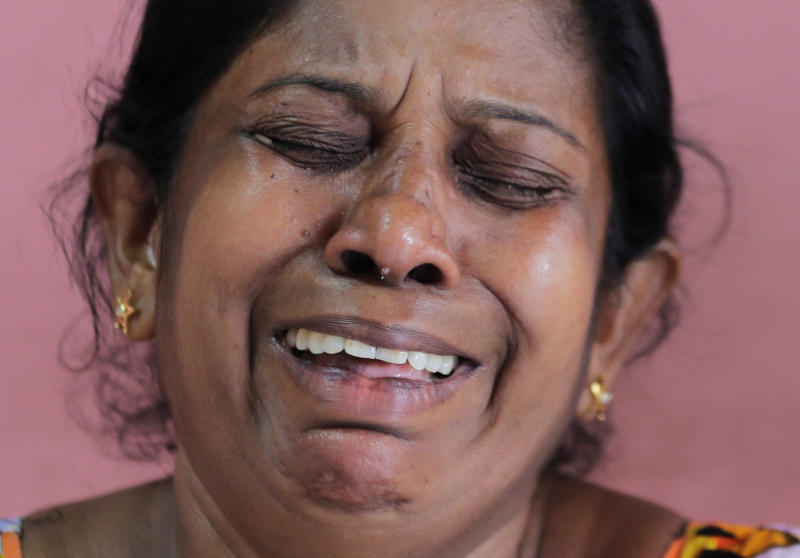 A 52-year-old Buddhist factory worker Anoma Damayanthi weeps as she talks about her 25-year-old daughter, married into a Christian family, who was seriously injured in the blast at St. Anthony's Church on Easter Sunday, at her residence in Colombo, Sri Lanka, Thursday, April 25, 2019. Liyanage herself was at St. Anthony's, and escaped the bomb only because she left a few minutes earlier with her Christian son-in-law when her 1 and a half-year-old granddaughter began crying too loudly. (AP Photo/Eranga Jayawardena)
