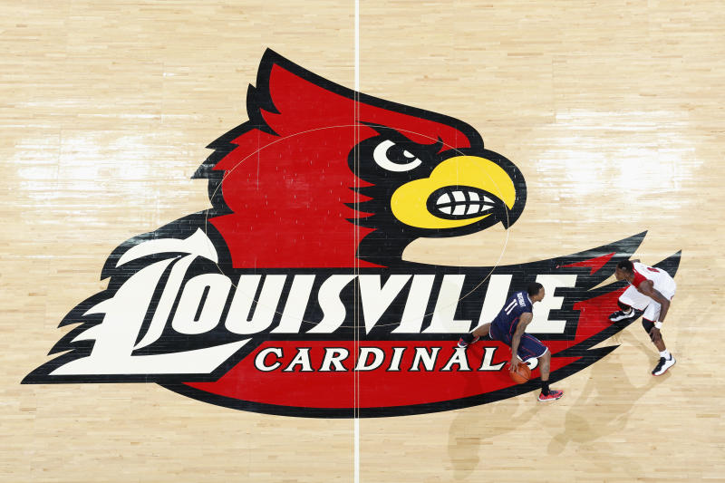 LOUISVILLE, KY - MARCH 8: General view of the Louisville Cardinals logo at midcourt as action takes place during the game against the Connecticut Huskies at KFC Yum! Center on March 8, 2014 in Louisville, Kentucky. Louisville won 81-48 to clinch a share of the American Athletic Conference championship. (Photo by Joe Robbins/Getty Images)