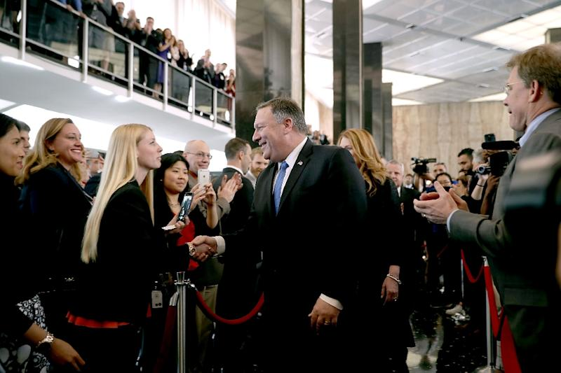 Trump visits State Dept for first time to swear in Pompeo