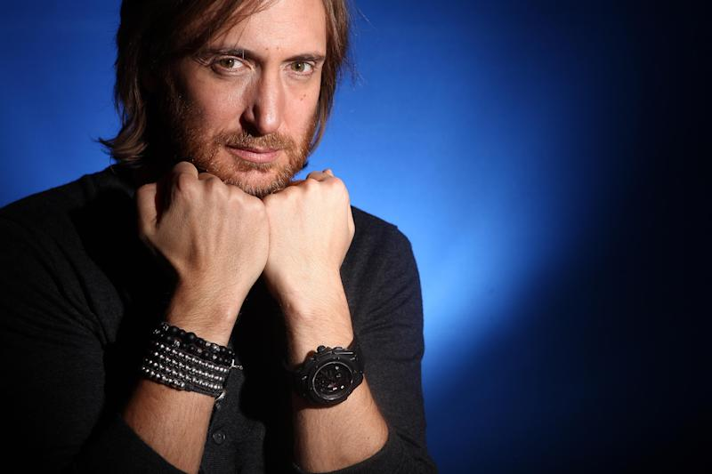 FILE - In this Dec. 8, 2011 file photo, music producer and DJ David Guetta poses for a portrait in New York. Guetta, who is from France, helped bring the electronic sound to America by collaborating with acts like the Black Eyes Peas, Kelly Rowland, Usher, Nicki Minaj, Akon and more. He has two Grammy Awards and six Top 40 hits on the Billboard Hot 100 chart. (AP Photo/Carlo Allegri, file)