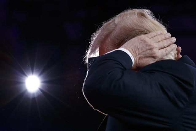 President Trump gestures as he makes a joke about his hair during remarks to the Conservative Political Action Conference, Feb. 23, 2018, in Oxon Hill, Md. (Photo: Evan Vucci/AP)
