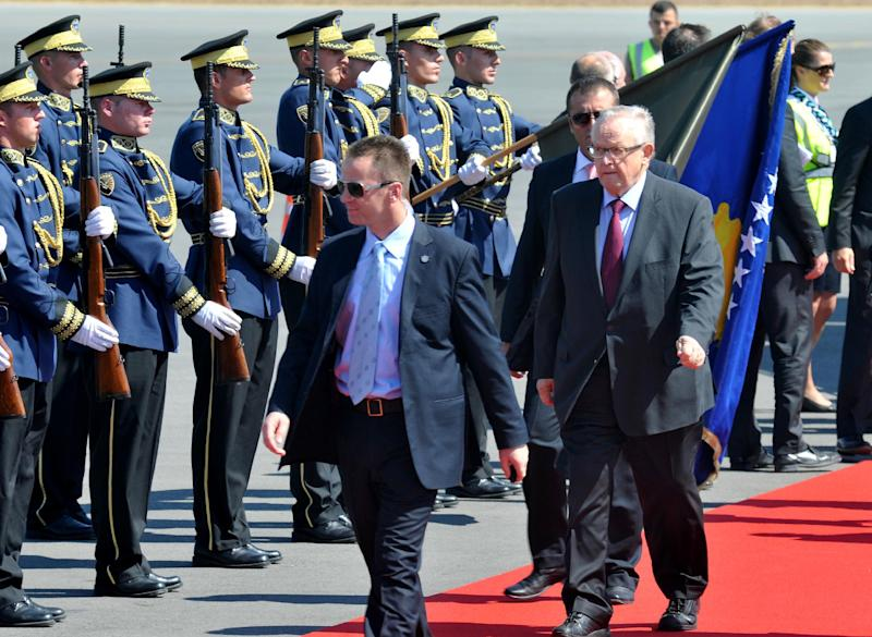 Former Finnish President and Nobel peace prize winner Martti Ahtisaari, right, reviews Kosovo Security Force honor guard as he arrives in Kosovo capital Pristina on Monday, Sept. 10, 2012. Western powers members of the International Steering Group, which has overseen Kosovo since its 2008 unilateral declaration of independence from Serbia are set to announce the end of supervision over the territory. (AP Photo/Visar Kryeziu )