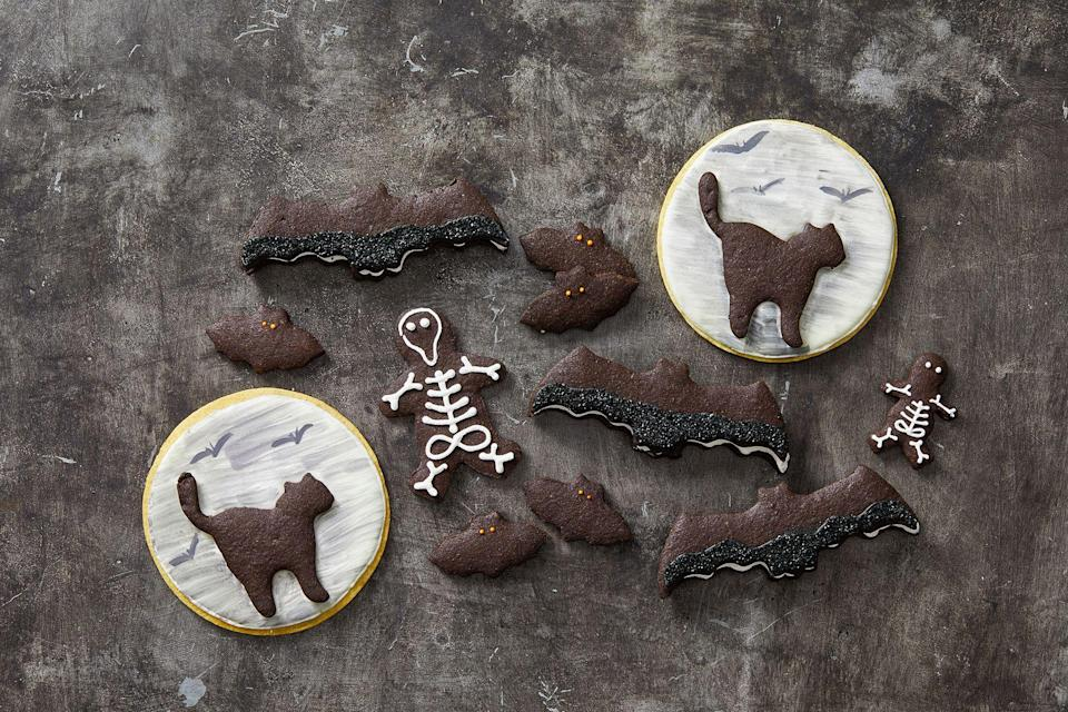"""<p>Come October 31, the best way to get in the spooky spirit is with homemade, decorated Halloween cookies. Whether you choose to make Halloween sugar cookies, meringues, sandwich cookies, or makeover ready-made baked goods, these easy and delicious <a href=""""https://www.goodhousekeeping.com/holidays/halloween-ideas/g244/halloween-desserts/"""" rel=""""nofollow noopener"""" target=""""_blank"""" data-ylk=""""slk:Halloween desserts"""" class=""""link rapid-noclick-resp"""">Halloween desserts</a> will serve as the ultimate warmup for your kid's trick-or-treating festivities. Plus, if you're planning a Halloween party, these grab-and-go treats, which are best served with one of these boozy (or non-alcoholic!) <a href=""""https://www.goodhousekeeping.com/holidays/halloween-ideas/g3718/best-halloween-cocktails/"""" rel=""""nofollow noopener"""" target=""""_blank"""" data-ylk=""""slk:Halloween cocktails"""" class=""""link rapid-noclick-resp"""">Halloween cocktails</a>, let your guests satisfy their sweet tooth without stealing the other <a href=""""https://www.goodhousekeeping.com/holidays/halloween-ideas/g3727/halloween-appetizer-recipes/"""" rel=""""nofollow noopener"""" target=""""_blank"""" data-ylk=""""slk:Halloween appetizers'"""" class=""""link rapid-noclick-resp"""">Halloween appetizers'</a>' thunder. (We're talking about deviled eyeballs, obviously.) </p>"""