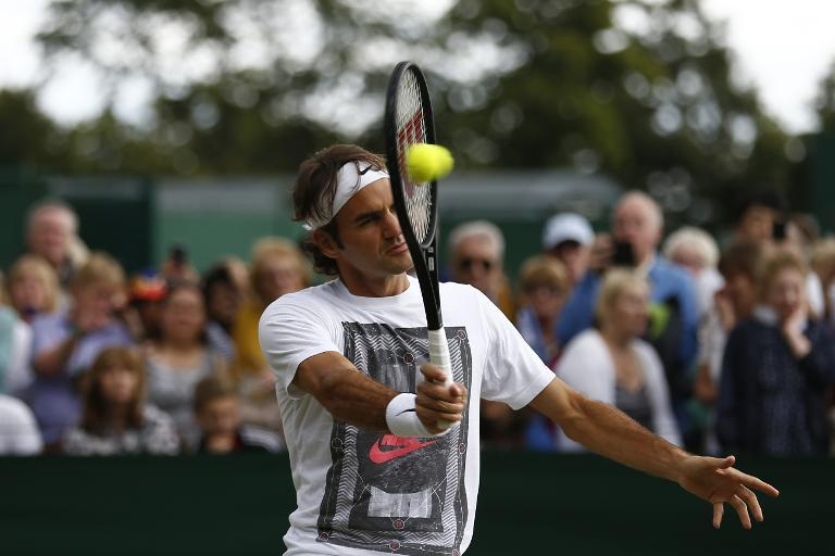 Roger Federer returns during a training session on day twelve of the 2014 Wimbledon Championships at The All England Tennis Club in Wimbledon, on July 5, 2014