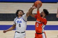 Pittsburgh's Ithiel Horton, left, blocks a shot by Syracuse's Alan Griffin during the second half of an NCAA college basketball game, Saturday, Jan. 16, 2021, in Pittsburgh. Pittsburgh won 96-76. (AP Photo/Keith Srakocic)