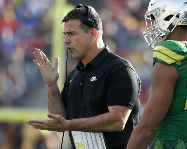 FILE - In this Dec. 16, 2017, file photo, Oregon head coach Mario Cristobal instructs his players during the first half of the Las Vegas Bowl NCAA college football game against Boise State, in Las Vegas. The non-conference schedule was cushy, so Saturday's game against Stanford will be a truer indicator of what first-year coach Mario Cristobal has in Eugene.(AP Photo/John Locher, File)