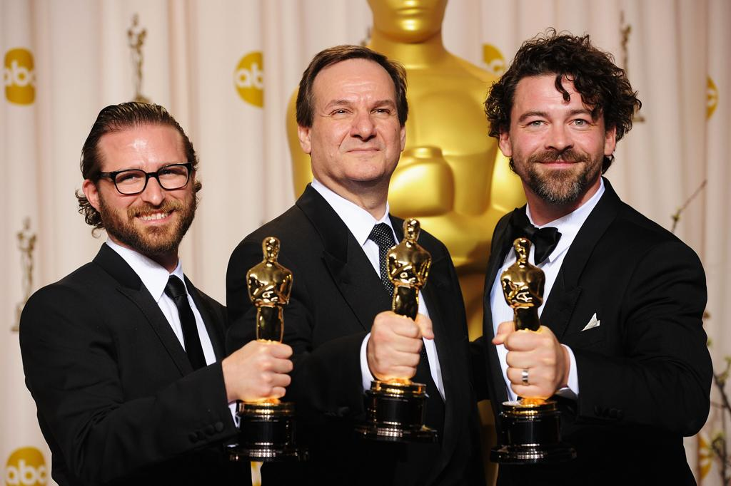(L-R) Alex Henning, Rob Legato, and Ben Grossman, winners of the Visual Effects Award for 'Hugo,' pose in the press room at the 84th Annual Academy Awards held at the Hollywood & Highland Center on February 26, 2012 in Hollywood, California.