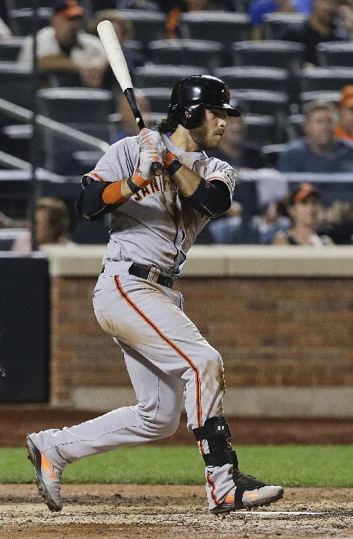 San Francisco Giants' Brandon Crawford follows through on a single during the ninth inning of a baseball game against the New York Mets on Friday, Aug. 1, 2014, in New York. (AP Photo/Frank Franklin II)