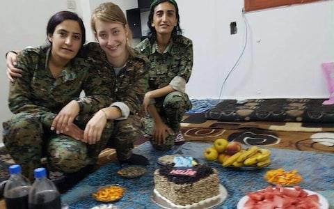 Chapman with YPJ fighters stationed in northern Syria - Credit: YPJ