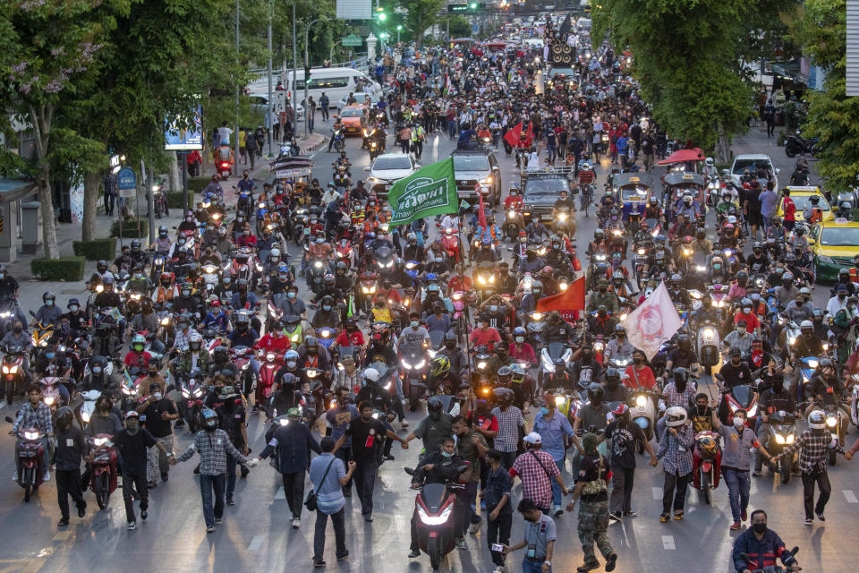 Pro-democracy supporters ride motorcycles in convoy during a demonstration in Bangkok, Thailand, Thursday, June 24, 2021. Pro-democracy demonstrators have taken to the streets of Thailand's capital again, marking the 89th anniversary of the overthrow of the country's absolute monarchy by renewing their demands that the government step down, the constitution be amended and the monarchy become more accountable. (AP Photo/Wason Wanichakorn)