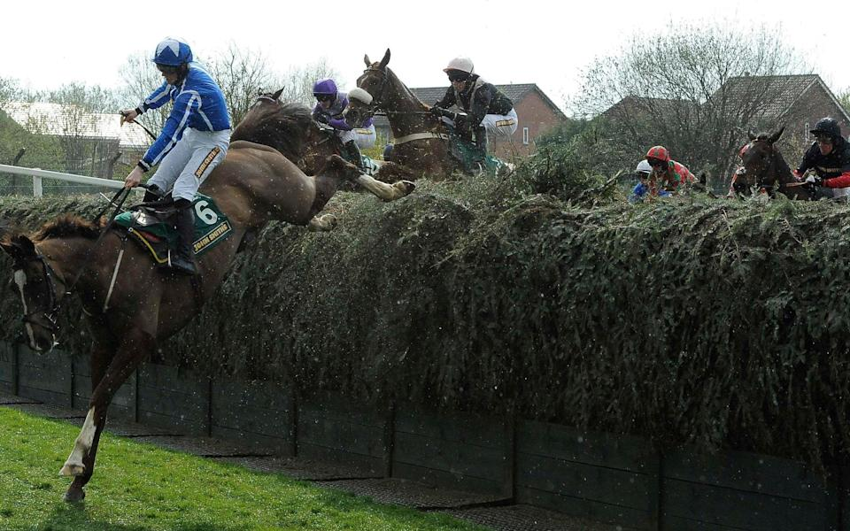 Sam Twiston-Davies jumps Beechers Brook during the John Smiths Topham steeple chase on the second day of the Grand National meeting at Aintree - Reuters