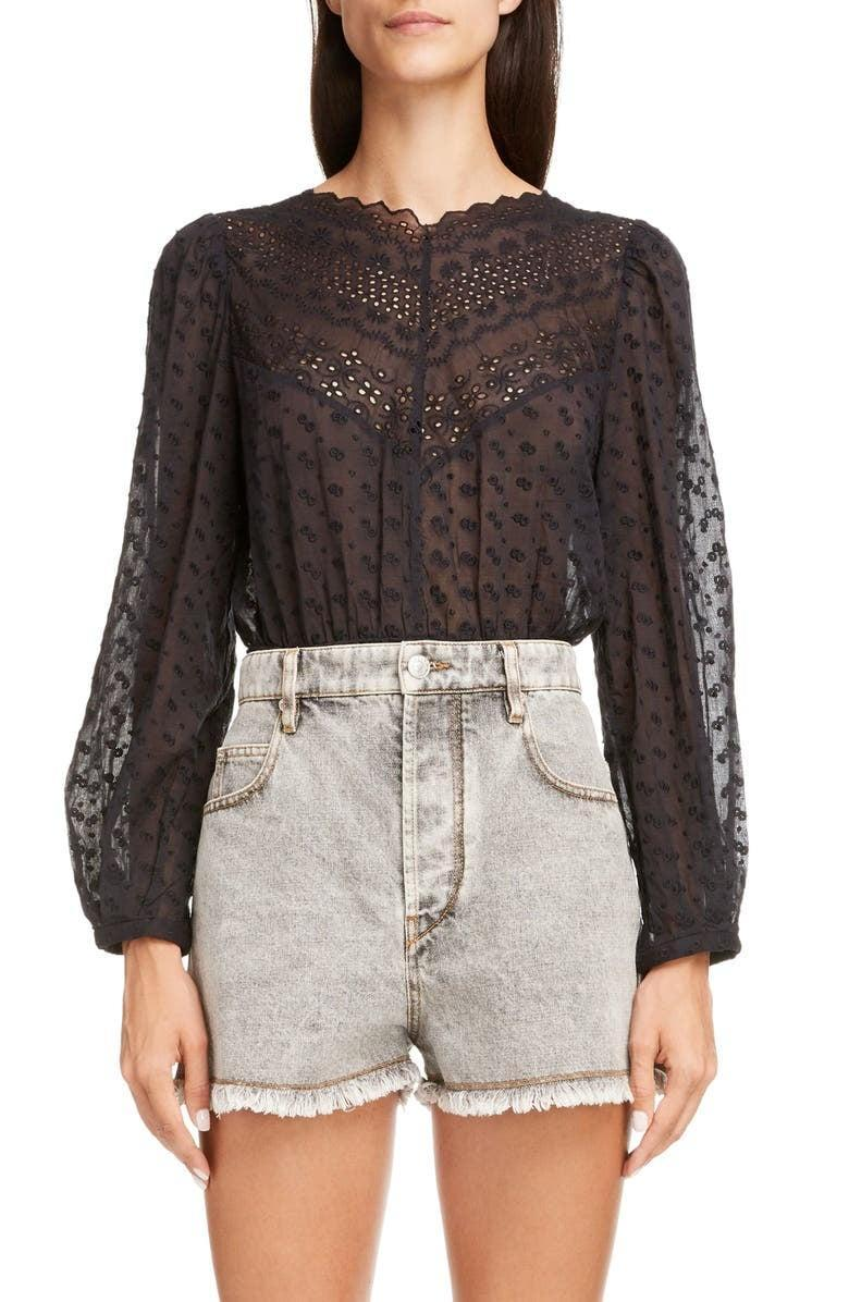 <p>This <span>Isabel Marant Etoile Taziae Reversible Embroidered Cotton Peplum Blouse</span> ($395) has a beautiful low back that makes this a winner in our books.</p>