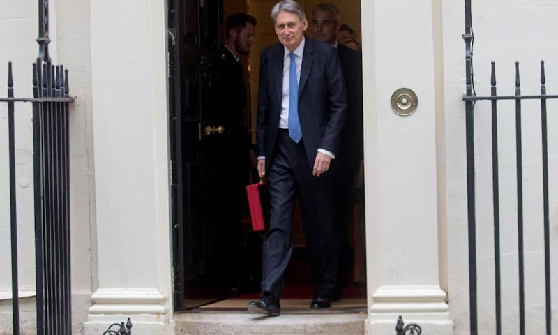 Philip Hammond holds the famous red box on the steps of N0 11 Downing Street