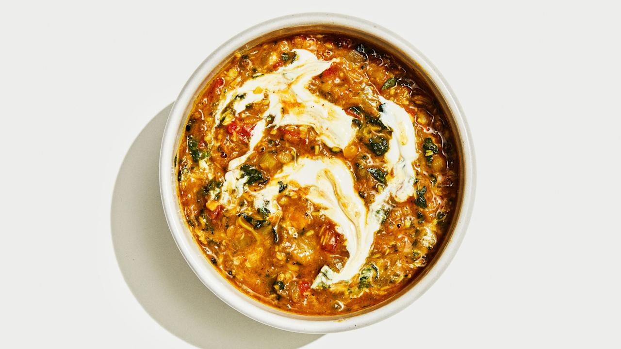 "Never has such a flavorful, hearty, and warming meal come together so quickly or using so many pantry staples. We love it with a dollop of yogurt on top, but feel free to omit or use a non-dairy yogurt to keep it vegan. <a href=""https://www.bonappetit.com/recipe/vegan-coconut-lentil-soup?mbid=synd_yahoo_rss"">See recipe.</a>"
