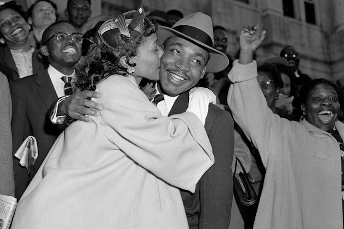 Martin Luther King Jr. is welcomed with a kiss from his wife, Coretta Scott King, after leaving court in Montgomery, Ala., on March 22, 1956. (Gene Herrick / AP)