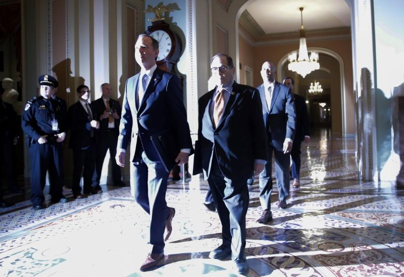 House managers arrive for procedural start of Senate impeachment trial of President Trump in the U.S. Capitol in Washington