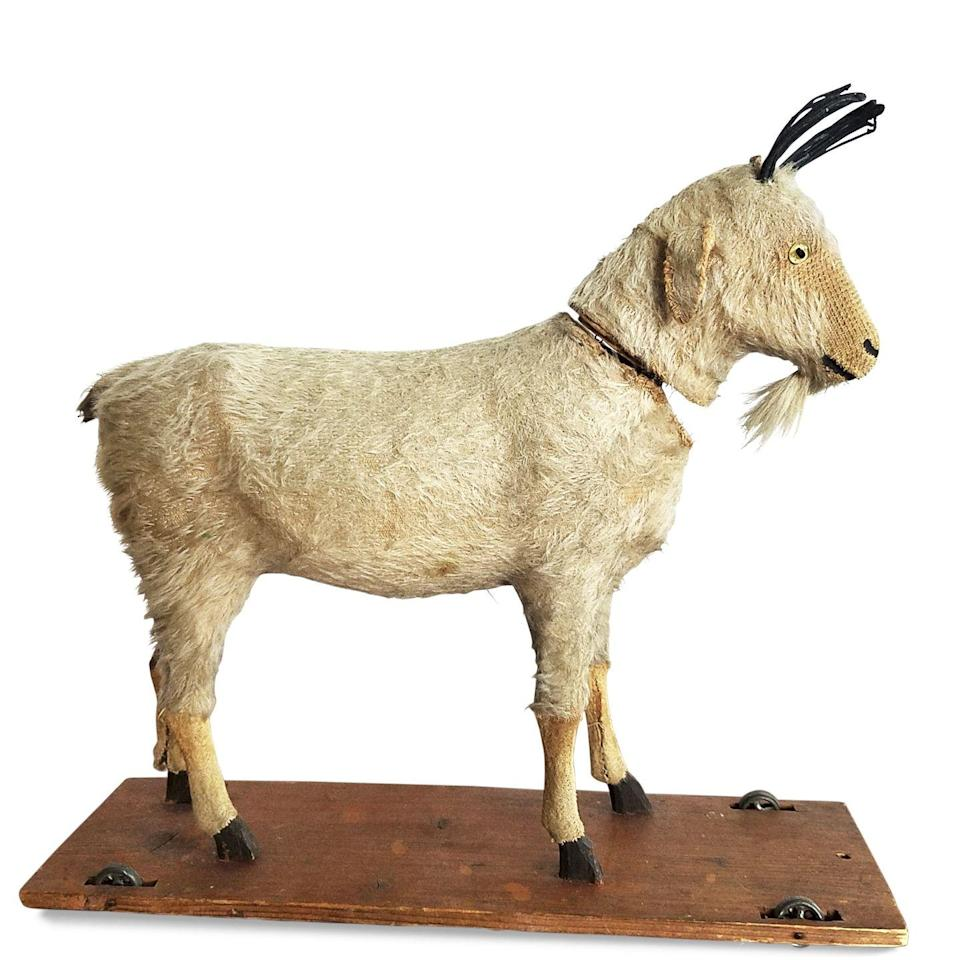 """<p>""""While unmarked, your adorable goat is likely a German-Made Pull Toy, imported to the United States during the early 1900s,"""" says appraiser Marsha Dixey. <a href=""""https://go.redirectingat.com?id=74968X1596630&url=https%3A%2F%2Fwww.ebay.com%2Fitm%2FVintage-Hard-Plastic-Mountain-Goat-Action-Figure-Animal-Toy-VTG-TAIWAN-Diorama%2F323565852015&sref=https%3A%2F%2Fwww.menshealth.com%2Ftrending-news%2Fg33657156%2Fvaluable-antiques%2F"""" rel=""""nofollow noopener"""" target=""""_blank"""" data-ylk=""""slk:Some German-made plush toys"""" class=""""link rapid-noclick-resp"""">Some German-made plush toys</a> were crafted of goat skin and real hair, but yours was constructed of papier-mâché and then flocked with a mix of natural fabric or paper fibers. Except for its disintegrated horns—and missing pull string—this toy appears to be in excellent condition, which keeps his value—and charm—high.</p><p><strong>What it's worth: </strong>$600</p>"""