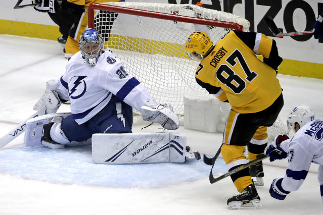 Pittsburgh Penguins' Sidney Crosby (87) puts the puck past Tampa Bay Lightning goaltender Andrei Vasilevskiy (88) for a goal in the first period of an NHL hockey game in Pittsburgh, Wednesday, Jan. 30, 2019. (AP Photo/Gene J. Puskar)