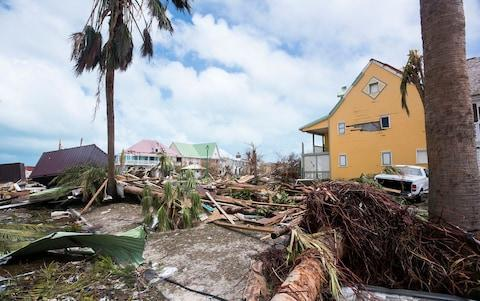 damage in Orient Bay on the French Carribean island of Saint-Martin - Credit: LIONEL CHAMOISEAU/AFP