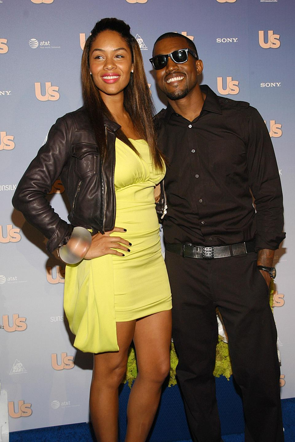 Alexis Phifer andKanye West and  on the red carpet