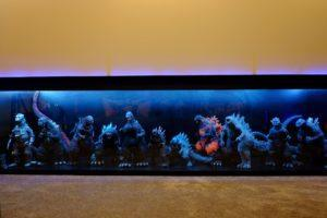 A lit display of Godzilla figurines in the home cinema. Photo: Helmi Abdat